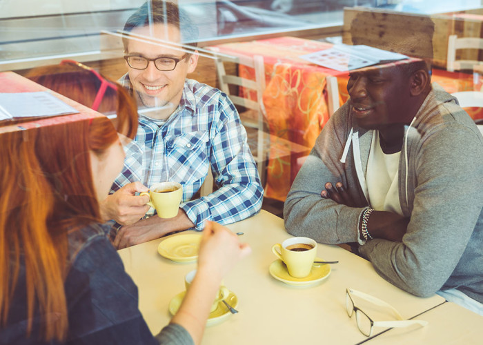 group of friends drinking coffee in a bar